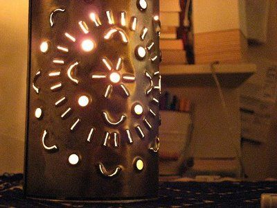 Tin Can Lanterns - The kids can create patterns and we can put citronella candles in them, yep, for the patio!
