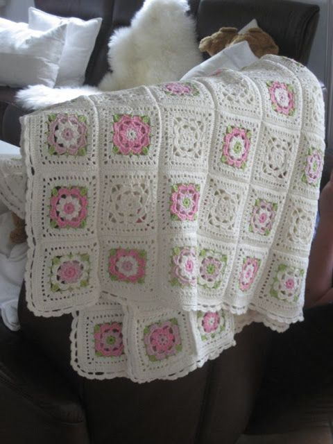 Pretty pink and white granny square baby afghan