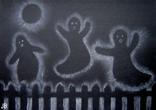 Draw ghosts on black paper with white pastel chalk