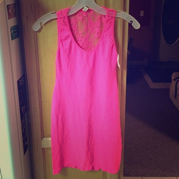 Barbie Pink Going Out Dress  This is a super cute & stretchy going out dress. Very bright colored and has never been worn. I bought it to wear for a themed party, but ended up being too short for the occasion! Backless & very cute! Fits small/medium. Charlotte Russe Dresses Backless