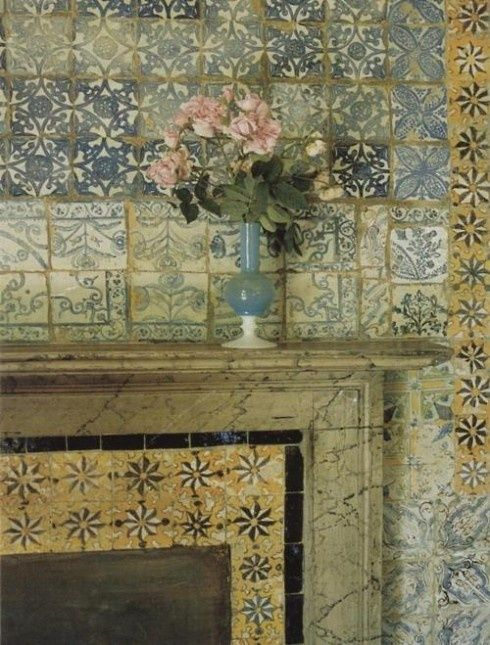 I would love a mantlepiece covered in old tiles.