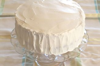 I love whipped cream frosting but found that just whipping cream with sugar and vanilla didn't hold up very well. I found this recipe in James McNair's Cakes and it is really good. Holds up well, is not too sweet and spreads nicely.