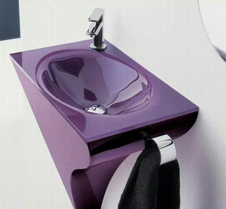 modern purple sink in a pale purple bathroom