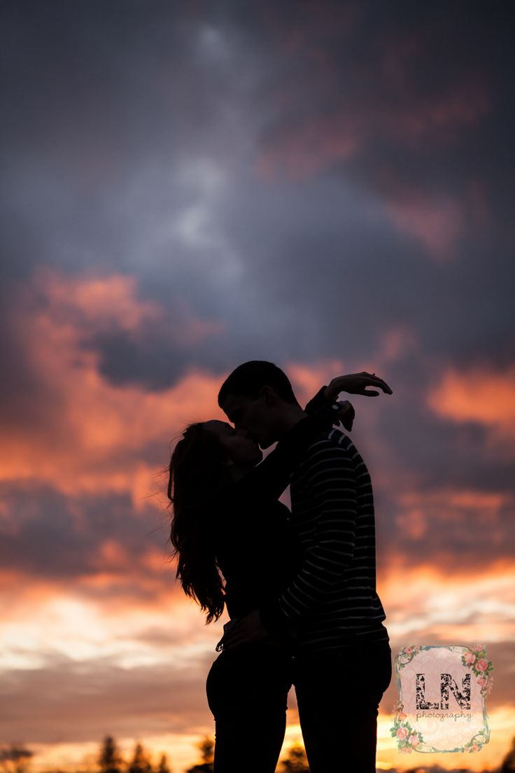 Romantic sunset engagement - silhouettes