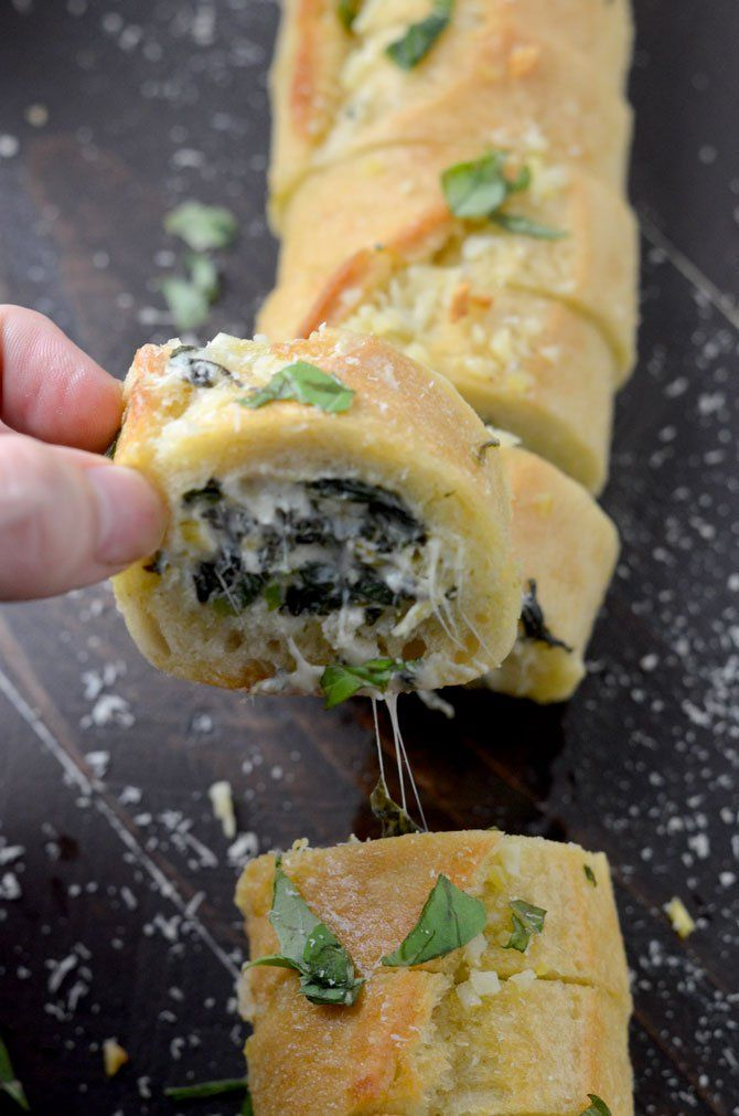 Spinach and Artichoke Dip Stuffed Garlic Bread. This is everything you've ever wanted in an appetizer and more. | hostthetoast.com
