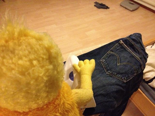 Flat Eric ironing Levi's, via Flickr.