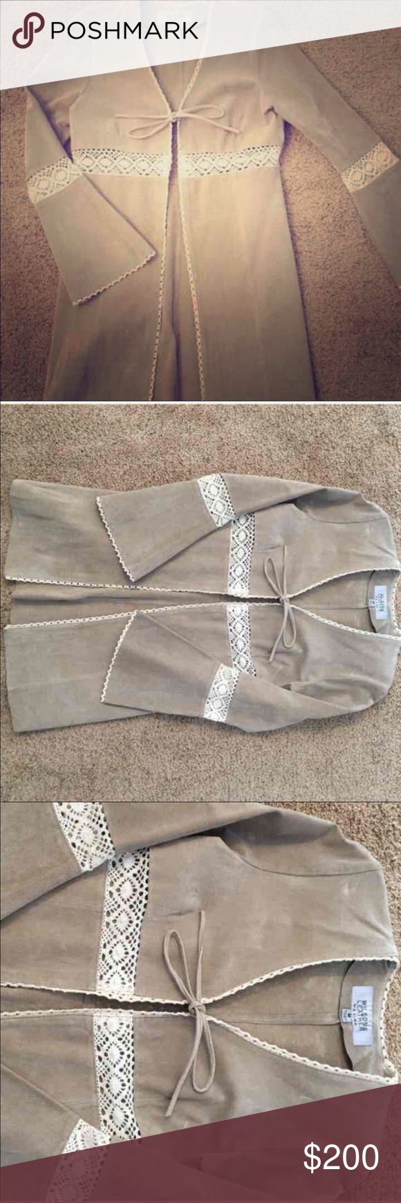Open to all offers~~Vintage leather jacket Beige colored, never worn leather jacket/coat. Ties in front. Comes down to about mid to high thigh. Crochet cut outs around elbows and stomach /under bust area. Size M. This is true vintage and very beautiful. Open to offers on this. Hate to let it go but it's not my size and it's too beautiful to sit in my closet any longer. Needs a good home❤️ Wilsons Leather Jackets & Coats