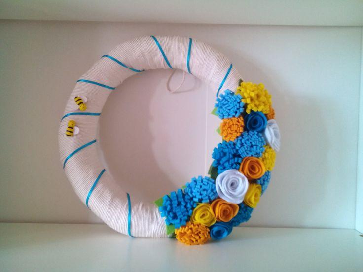 Handmade wreath with felt flowers.