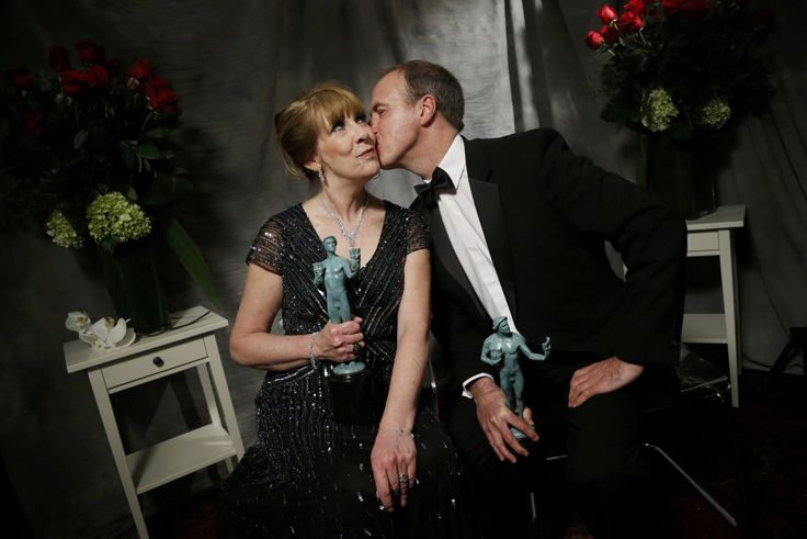 Downton Abbey's actors Phyllis Logan and Kevin Doyle, pose backstage with the award for Outstanding Performance by an Ensemble in a Drama Series at the 22nd Screen Actors Guild Awards..