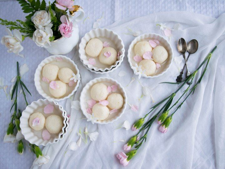 Soft, spongy Rasgullas (cheese balls) in a rose flavoured sugar syrup. Gluten free, egg free with minimum ingredients.
