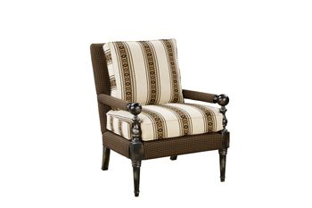 Hand-carved details define the frame of the American West #chair by Paladin, which is clad in patterned #upholstery and additional padding on the arms ($1,725).