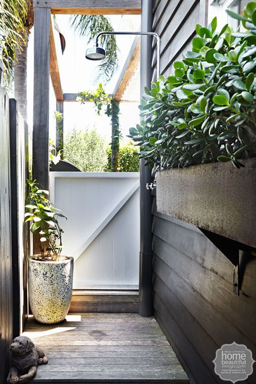 French affair: the courtyard features an outdoor shower and pre-rusted trough.