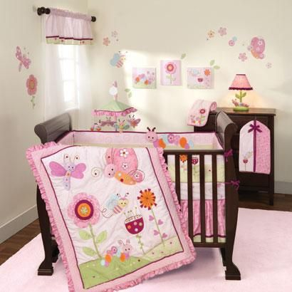 Butterfly and caterpillar baby bedding. Pink, berry, and orange girl baby bedding set. Garden Butterflies crib bedding for any infant girl. Sunshine Garden baby crib bedding set by Lambs & Ivy.
