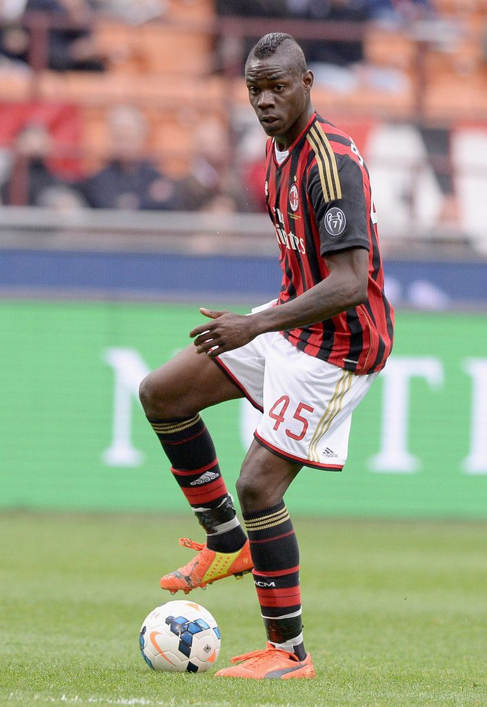 Mario Balotelli in action during the Serie A match between AC Milan and AS Livorno Calcio at San Siro Stadium on April 19, 2014 in Milan, Italy.