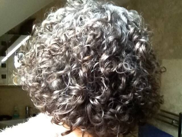 I can't wait until my hair is all one color.  Grey curls rock!