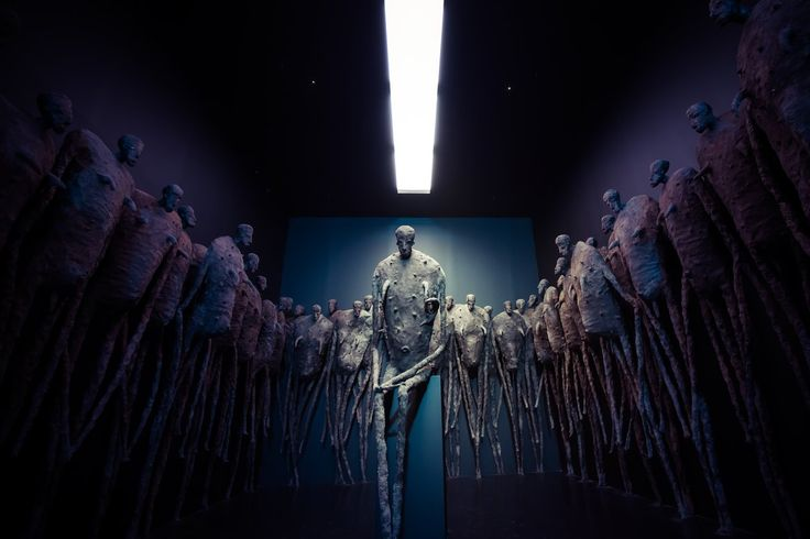 Nightmare room idea, dark and eyes slowly adjust to see large figure statues surrounding them