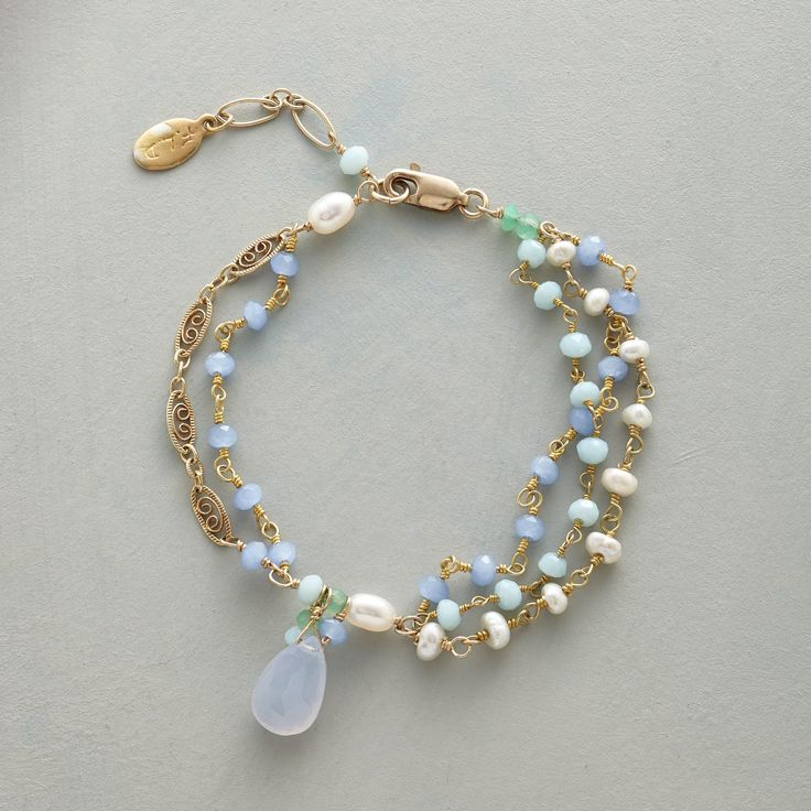 "LOVING THE BLUES BRACELET -- Triple strands of blue chalcedony, amazonite, freshwater cultured pearls and aventurine, spaced by 14kt gold filled links, dangle a bright blue chalcedony drop. 14kt gold filled lobster clasp. Handmade exclusively for Sundance. 7"" to 7-3/4""L."