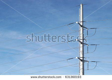 electric pylon high voltage distribution infrastructure electricity on blue sky