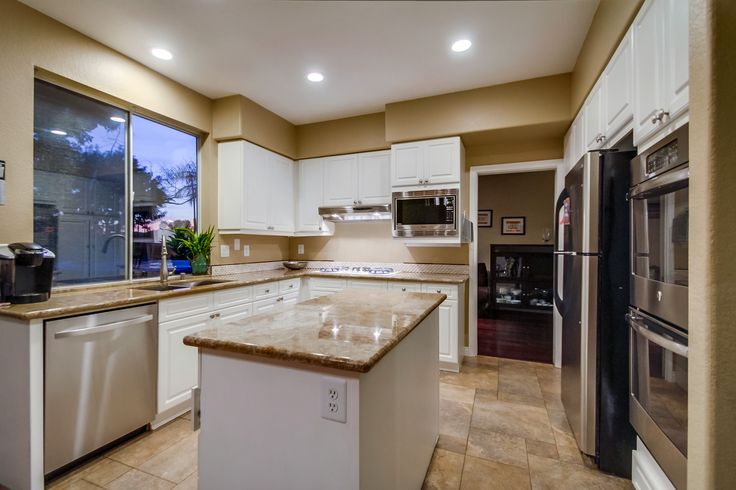 This gorgeous kitchen on our new listing on 741 Calle Montera in Escondido is 4 beds, 2.5 baths, has a 3 car garage and is in a gated community right down the street from the I-15 freeway and North County Fair mall!