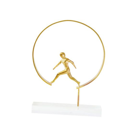 A superb Marathon Running Figure from Greece  on a perspex stand.  Casted bronze and perspex. Designed,made and signed by Greek artist Louisa Dimitriou.