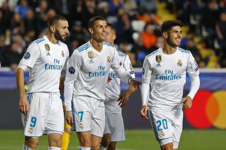 Cristiano Ronaldo Photos - Real Madrid's Portuguese forward Cristiano Ronaldo (2nd-R) celebrates with teammates his first goal, and his team's fifth, during the UEFA Champions League Group H match between Apoel FC and Real Madrid on November 21, 2017, in the Cypriot capital Nicosia's GSP Stadium.  / AFP PHOTO / Jack GUEZ - APOEL Nikosia v Real Madrid - UEFA Champions League