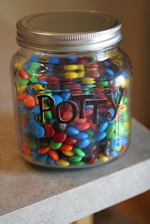 Potty training treat jar. Maybe replace chocolate with something healthier :)