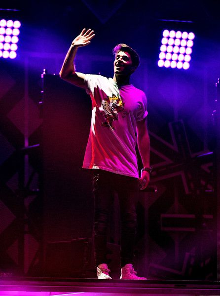 Andrew Taggart Photos Photos - Recording artist Andrew Taggart of music group The Chainsmokers performs onstage at 106.1 KISS FM's Jingle Ball 2016 presented by Capital One at American Airlines Center on November 29, 2016 in Dallas, Texas. - 106.1 KISS FM's Jingle Ball 2016 - Show