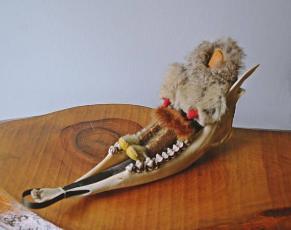 Check out this item in my Etsy shop https://www.etsy.com/ca/listing/525706587/1970s-caribou-jawbone-dog-sled-with