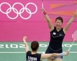 Japan's Reika Kakiiwa and Mizuki Fujii celebrate after winning against Denmark during their women's doubles quarter-finals match during the London 2012 Olympic Games at the Wembley Arena