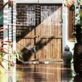 Coffee BamDeck® Composite Bamboo Decking and Black Bamboo Gate