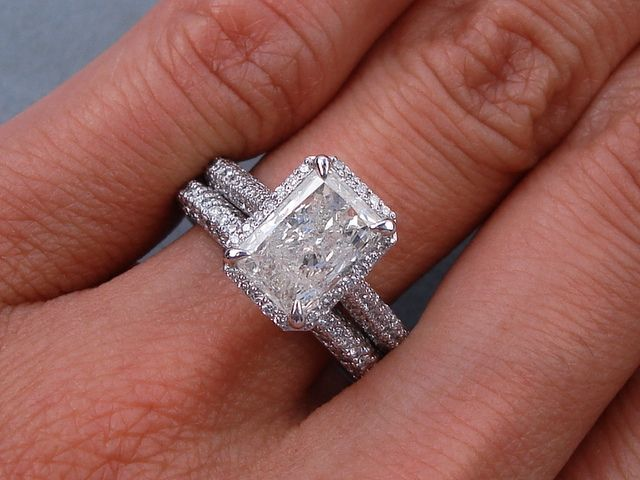 2.50 ctw Radiant Cut Diamond Engagement Ring Set. It has a charming 1.53 ct I color/I1 clarity, Radiant Cut center diamond. Set in a beautifully designed 14k White Gold setting, this ring set is listed for $5,990. Follow this link to view this listing on our website: http://www.bigdiamondsusa.com/2ctwracutdiw1.html Contact Information: 1-877-795-1101 Toll Free 1-312-795-1100 International
