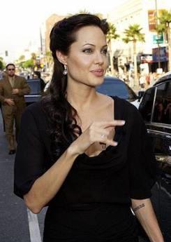 Angelina Jolie, pledging her alligiance to Satan