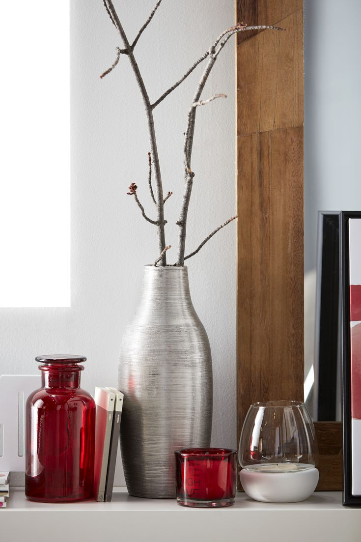 Bring a touch of shimmer into your home with this stylish vase. Made of ceramic with a silver finish, this piece has a sculptural effect that will turn heads in any modern space. Bold enough to stand on its own, it also plays well with other items as part of a striking vignette. Pick one up and have fun styling it into your home.