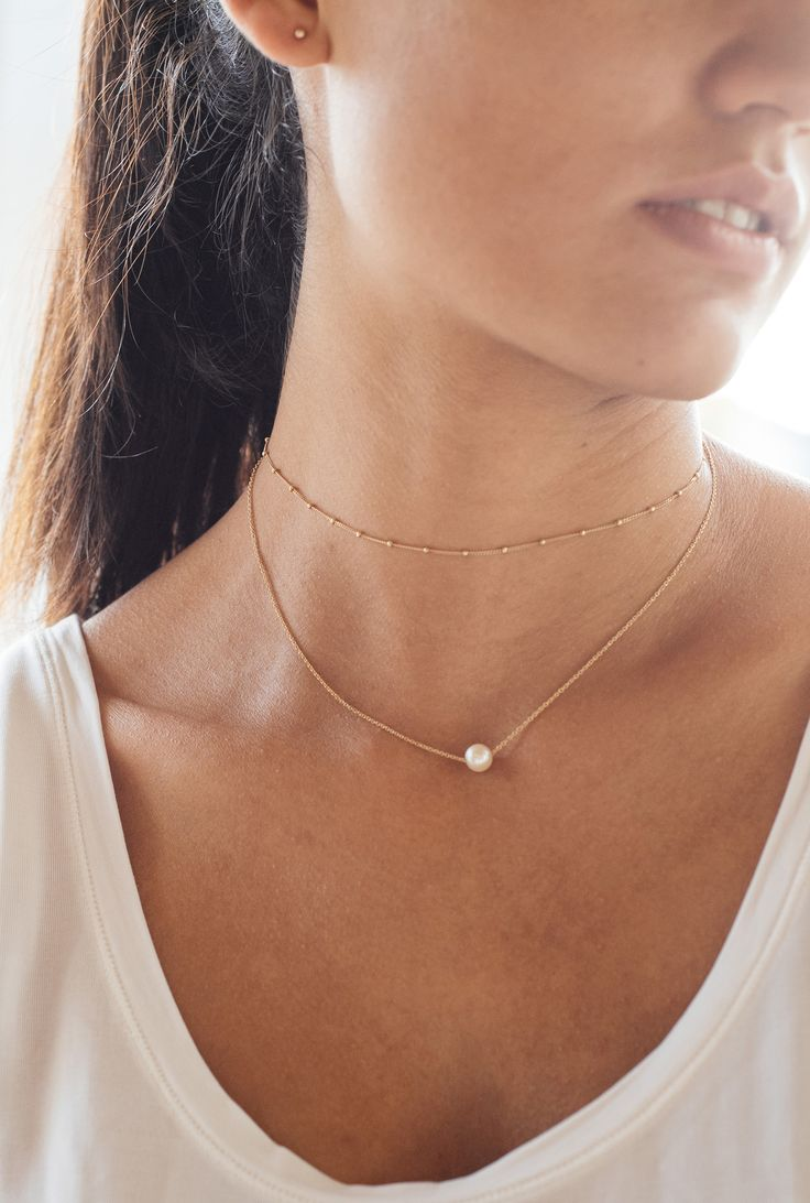 Mejuri spheres choker and pearl necklace in 14 solid gold.