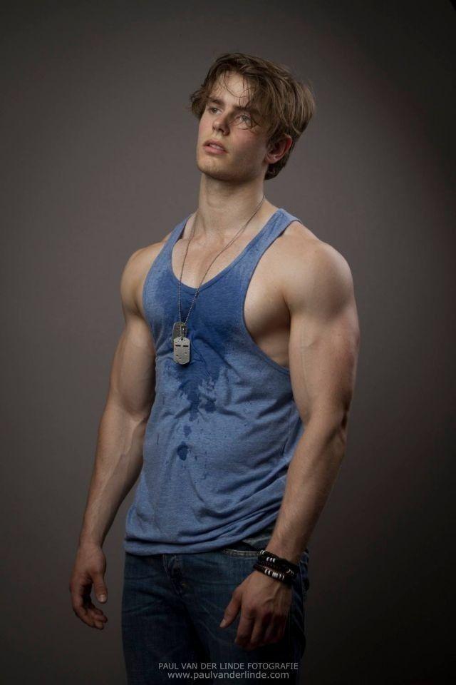 gay muscular man in silk shirt