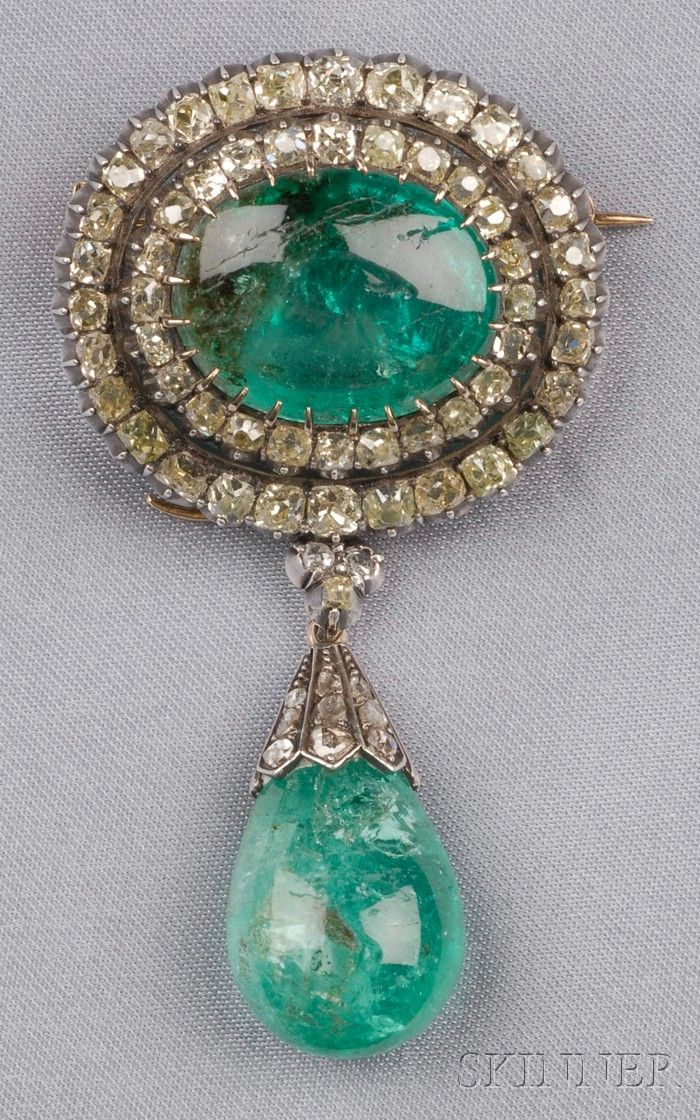 Antique Emerald and Diamond Pendant/Brooch, prong-set with a cabochon emerald measuring approx. 18.80 x 14.75 x 8.15 mm, framed by old mine-cut diamonds and yellow diamonds, approx. total diamond wt. 3.50 cts., suspending a detachable emerald drop measuring approx. 16.75 x 14.10 x 11.10 mm, rose-cut diamond accents, silver-topped gold mount.