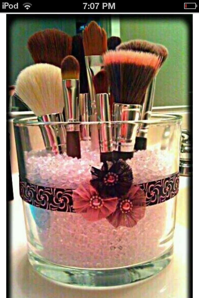 Fill a decorated candle jar with beads to keep makeup brushes or makeup products organized on a vanity