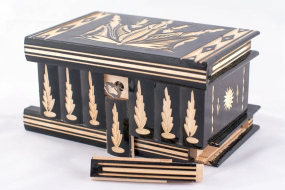 It looks like an innocent and solidly-locked box on the outside, but when you play around with it, you realize that there is more to it. A puzzle box of