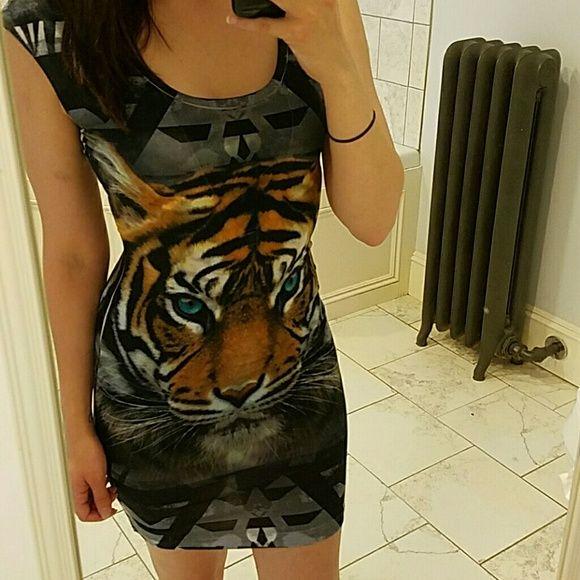 Tiger print dress Sleeveless tight tiger print dress. Scoop back. Very soft. Dresses
