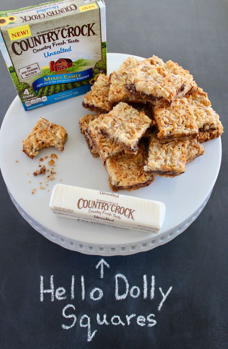 Holly Jolly Hello Dolly Squares: 1 cup sweetened flaked coconut 9 graham crackers, crushed 8 tbsp. Unsalted Country Crock® Buttery Sticks 1 cup chopped walnuts 1 cup semisweet choco chips ½ cup white choco chips ½ cup butterscotch chips 14 oz. swt condensed milk Directions: Preheat oven 350°F Mix graham crackers and Country Crock® Buttery Sticks together. Press mix on bottom of 9x13 pan. Layer walnuts, chips, and coconut. Pour condensed milk over ingredients. Bake 24 minutes. Cool then cut.
