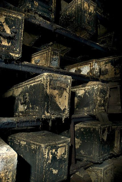 "London West Norwood Catacombs: Note ""hobnail"" line patterns on velvet covered (now rotting away) coffins."