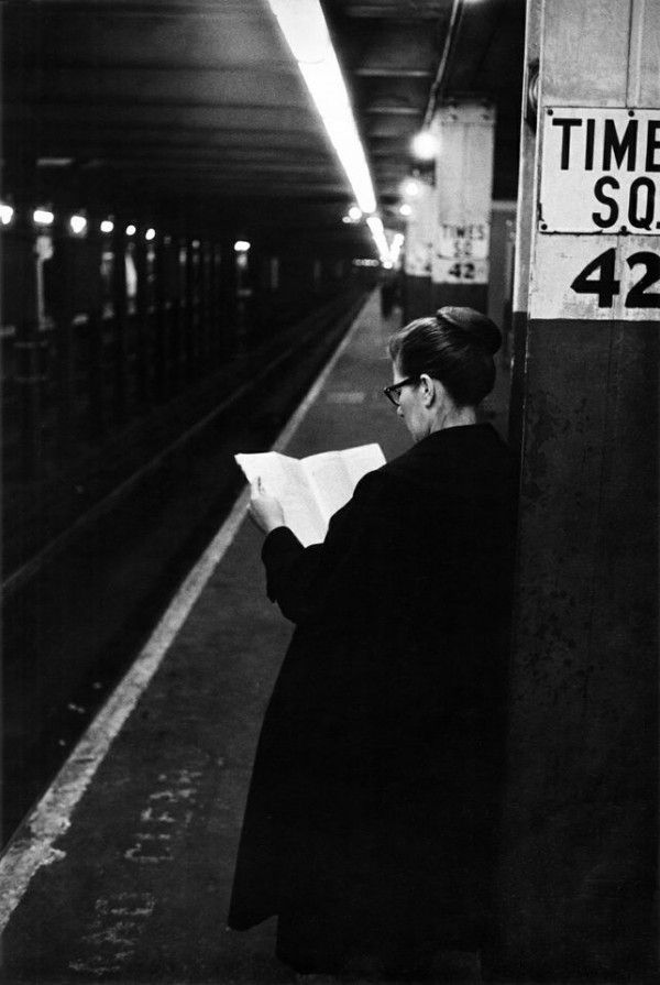 Woman reading while waiting for subway. Jesse A. Fernández. Times Square, New York, 1960s. Fernández (Cuban, 1925-1986)