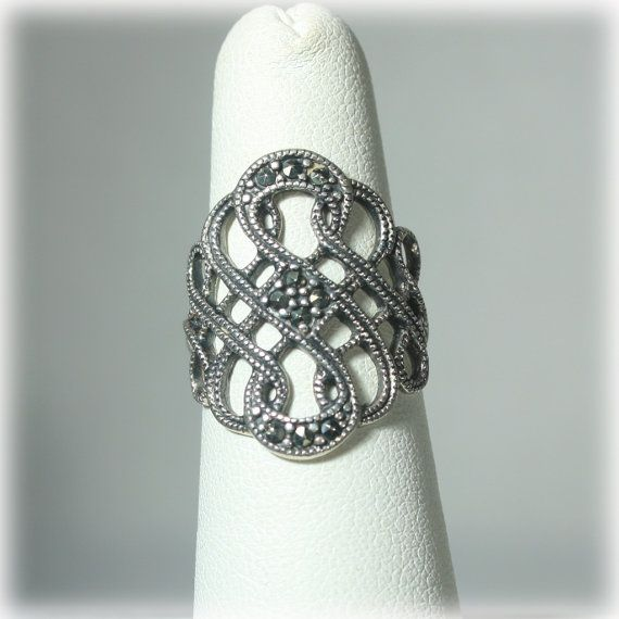 Hey, I found this really awesome Etsy listing at https://www.etsy.com/listing/212993586/woven-open-work-sterling-marcasite-ring