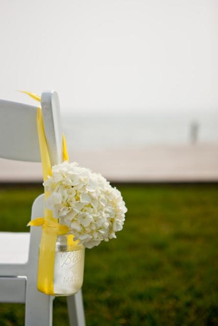White Hydrangea in yellow ribboned, hanging Mason jar.
