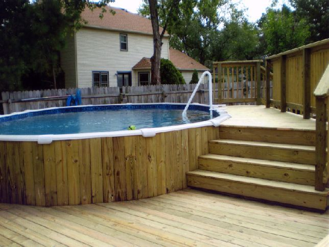 Love the wood plank siding on pool with the multi level for Multi level deck above ground pool