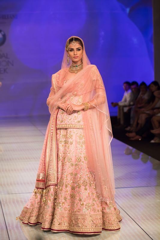 Tarun Tahiliani pink and gold conservative lehenga. More here: http://www.indianweddingsite.com/bmw-india-bridal-fashion-week-ibfw-2014-tarun-tahiliani-show/