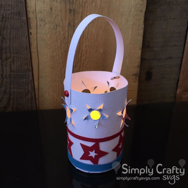 Make one or several tealight holders for your next 4th of July celebration with the FREE Stars Mini Lantern SVG File. Indepedence Day SVG to make a mini lantern. #simplycraftysvgs #freesvg