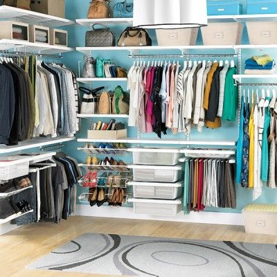 Minus the colour - love how this closet is organized. Just needs an island  in