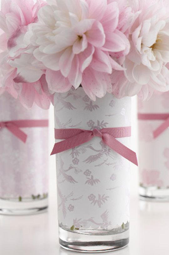 So pretty! Wrap glass tumblers with patterned paper and add ribbon.