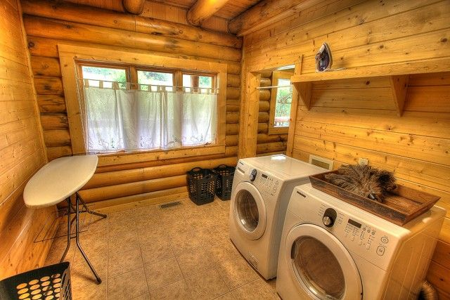 This laundry room complete with ironing board, stand along washer and dryer, iron and even clothes hampers is everything you'll ever need on vacation.